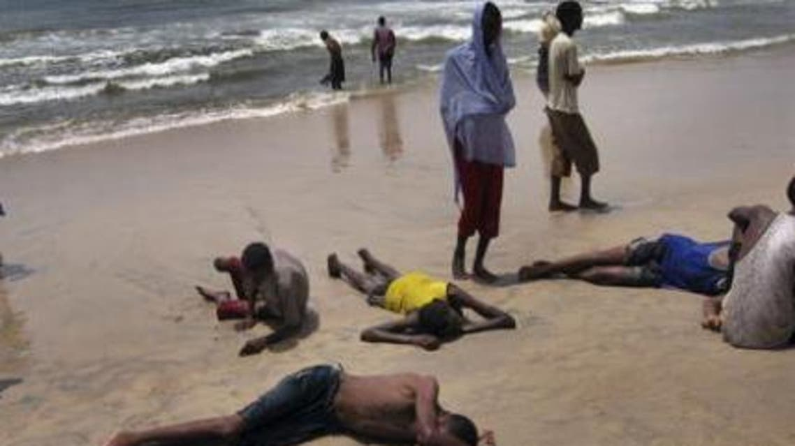 Illegal Somali immigrants rest on a beach in Ahwar in south-central Yemen in this July 3, 2008 picture. (Photo courtesy: Africa Review)