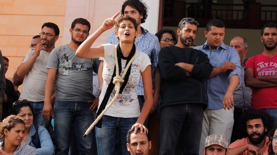 A protester shouts slogans calling for the release of protesters who were arrested after clashes with police, outside a court in the central city of Sidi Bouzid in 2012. (Reuters)