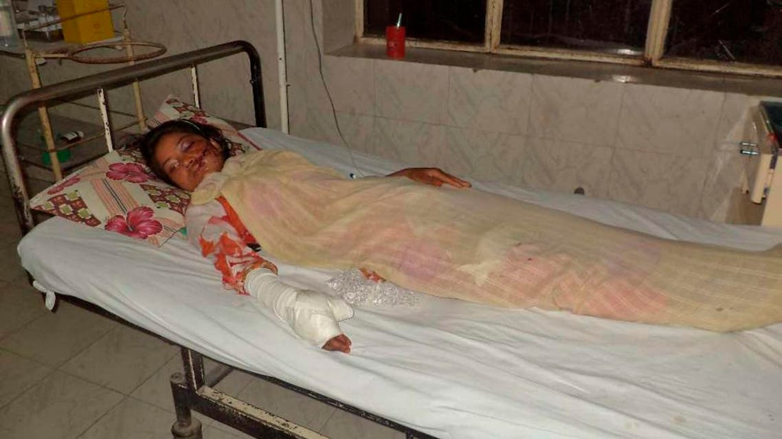 Saba Maqsood, 18, lies on a hospital bed in Hafizabad in Punjab Province June 5, 2014. reuters