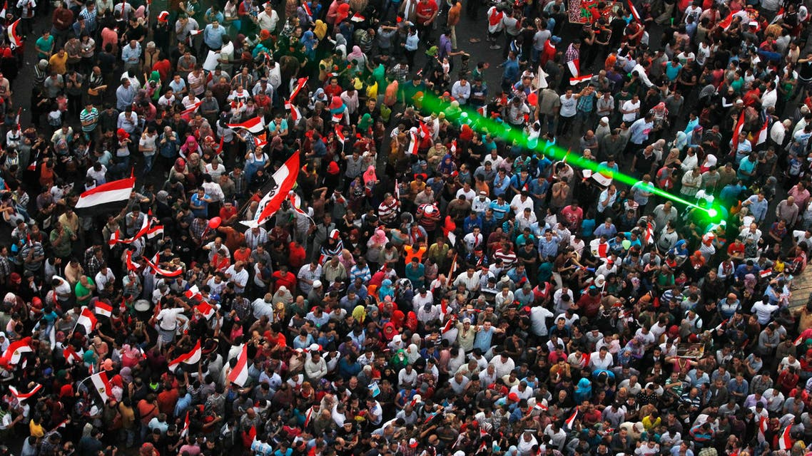 Egyptians celebrate after the swearing-in ceremony of president elect Abdel Fattah al-Sisi in Tahrir square in Cairo, June 8, 2014. (Reuters)