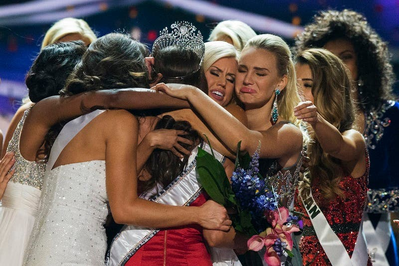 Fellow contestants celebrate with Miss Nevada Nia Sanchez after she won the 2014 Miss USA beauty pageant in Baton Rouge, Louisiana June 8, 2014. (Reuters)