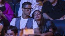 Ronaldo's girlfriend struggles to keep awake at boxing match