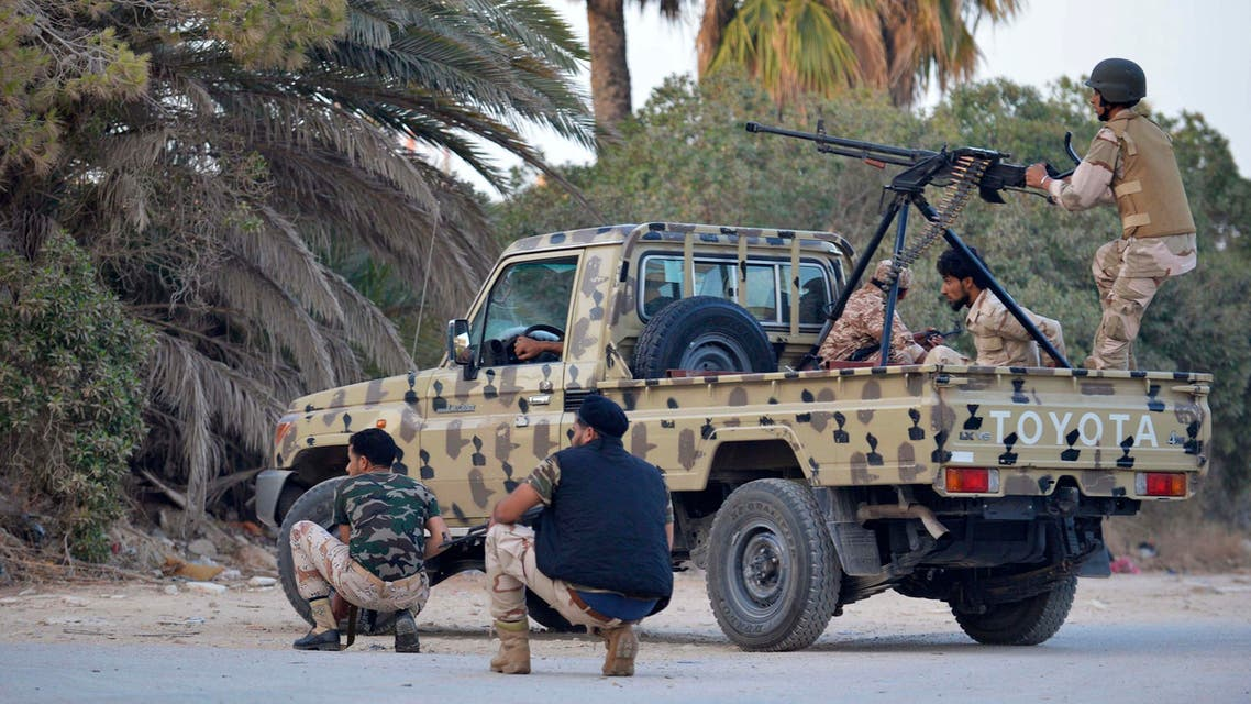 rregular forces loyal to former army general Khalifa Haftar stand by an armed vehicle during clashes with Islamist militants in the eastern city of Benghazi June 2, 2014