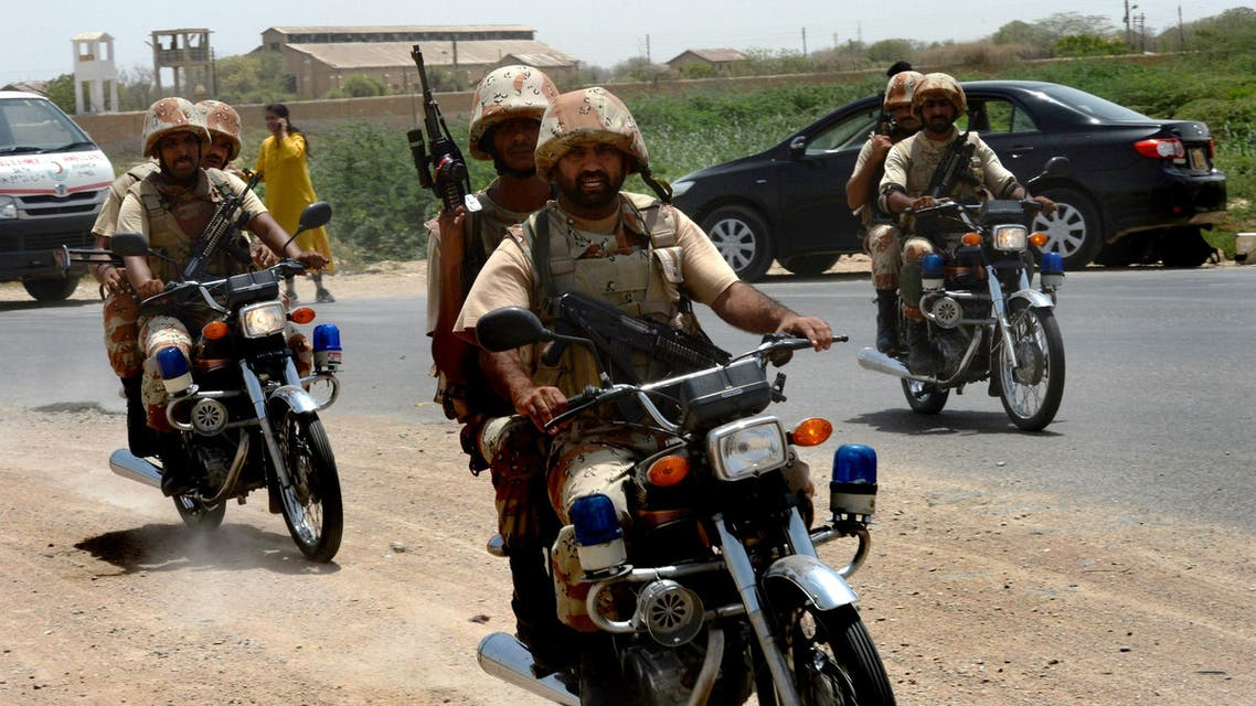 Pakistani security personnel rush towards the firing incident near Karachi airport in Karachi on June 10, 2014. (AFP)