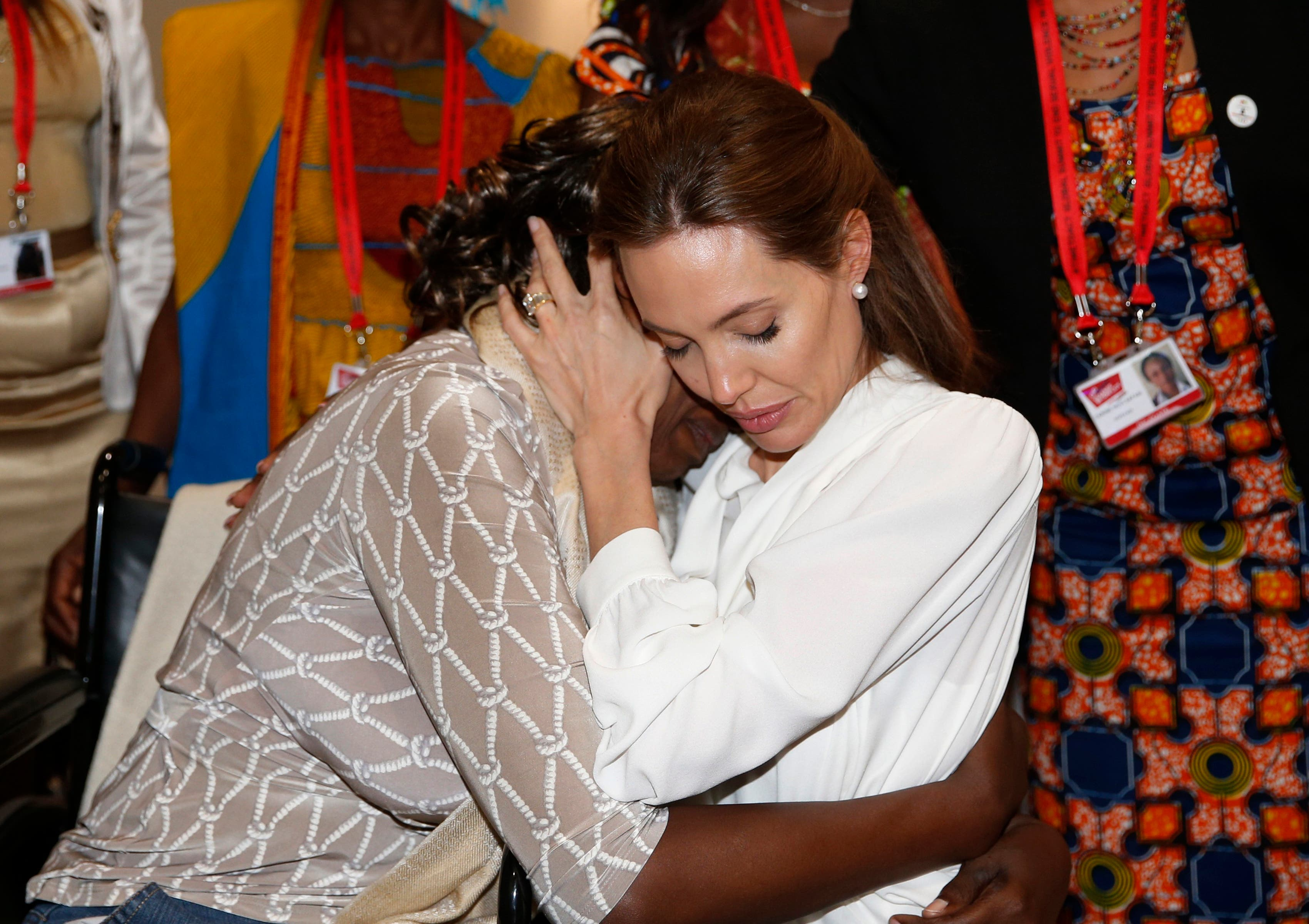 Angelina Jolie hugs Neema Namadamu at the 'End Sexual Violence in Conflict' summit. (Reuters)