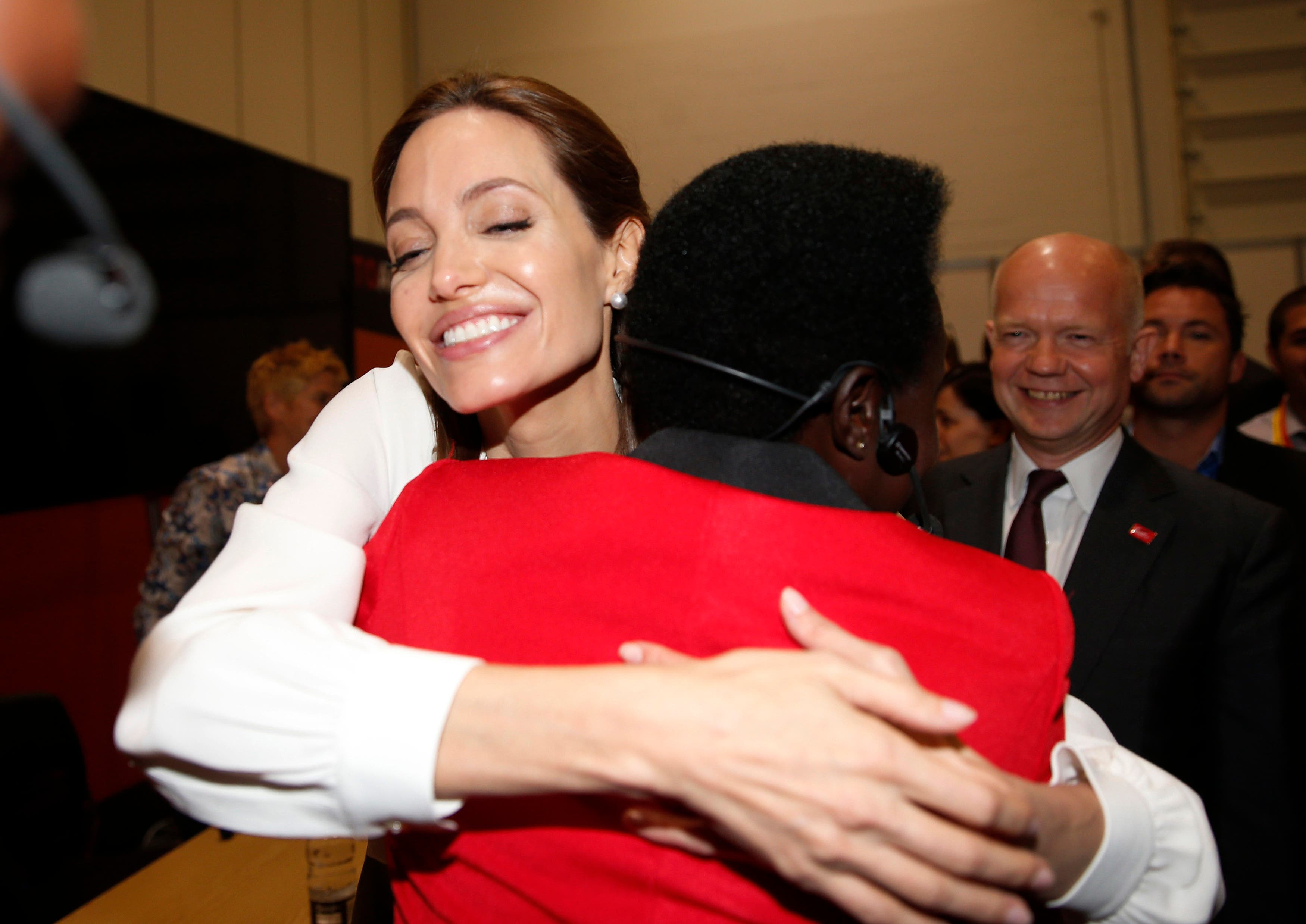 Angelina Jolie embraces a delegate at the 'End Sexual Violence in Conflict' summit. (Reuters)