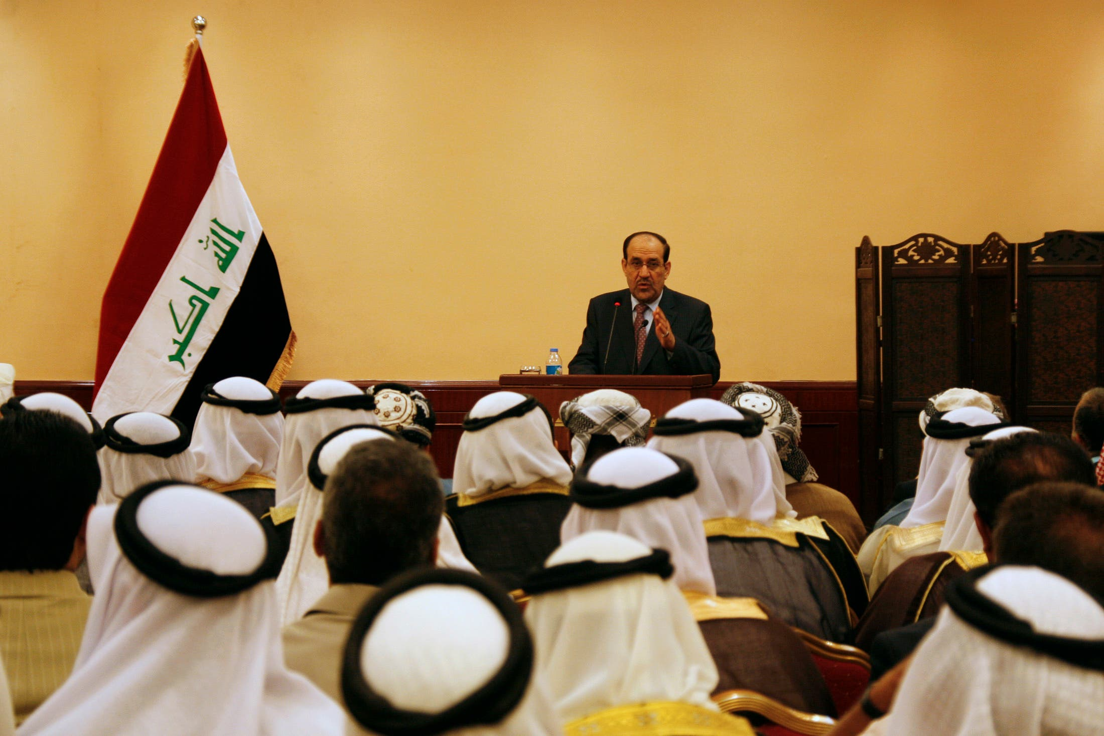 Iraq's Prime Minister Nuri al-Maliki speaks during a meeting with tribal leaders in Mosul in 2012. (AFP)
