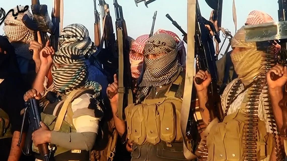the jihadist group the Islamic State of Iraq and the Levant (ISIL) allegedly shows ISIL militants near the central Iraqi city of Tikrit. Militants battled Iraqi security forces in Tikrit on June 11, 2014. (AFP)