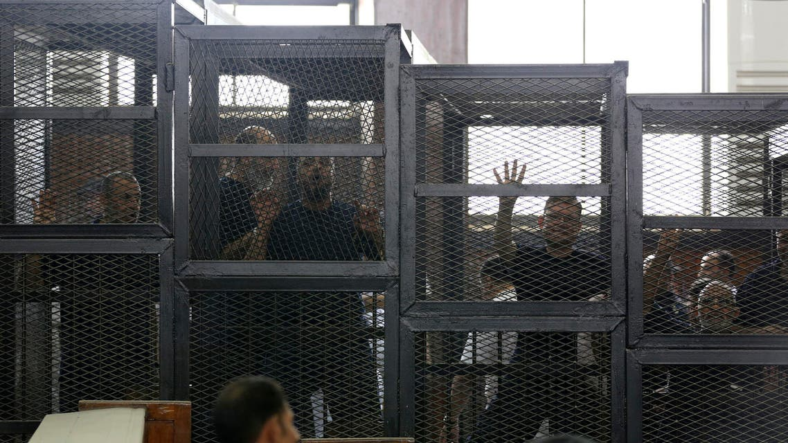Muslim Brotherhood's General Guide Mohamed Badie (R) is pictured in a defendant's cage with other defendants in a courtroom in Cairo June 7, 2014. (Reuters)