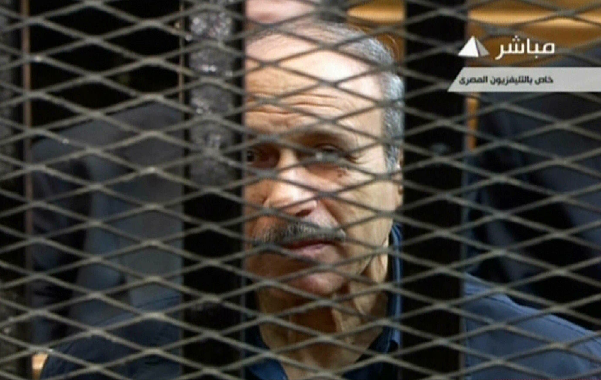 An image grab taken from Egyptian state TV shows former Egyptian interior minister Habib al-Adly behind bars during a retrial at the Police Academy in Cairo on April 13, 2013. AFP