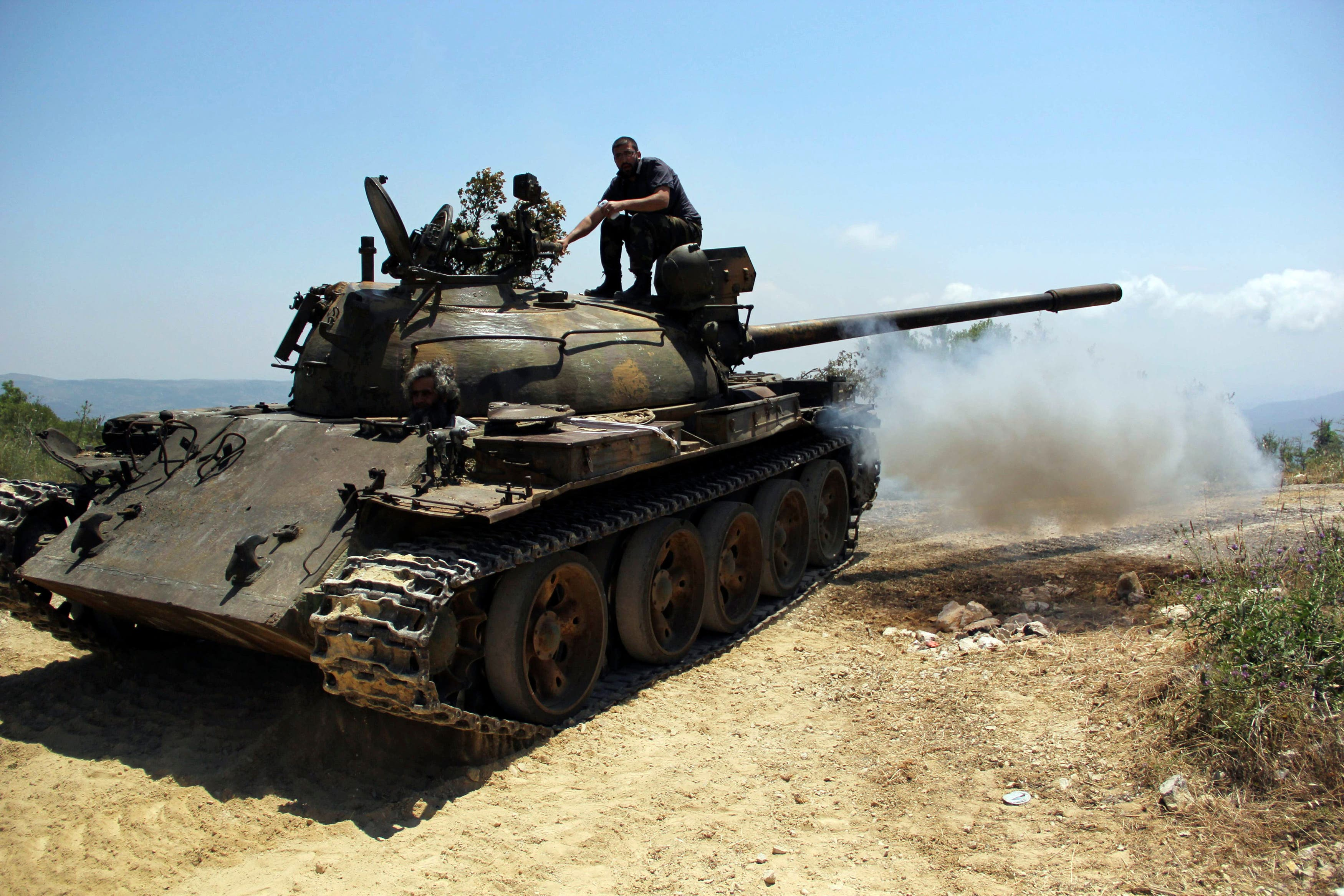 Rebel fighters are seen on a tank during what they said an offensive against forces loyal to Syria's President Bashar al-Assad who are positioned around the Armenian Christian town of Kasab May 26, 2014. (Reuters)