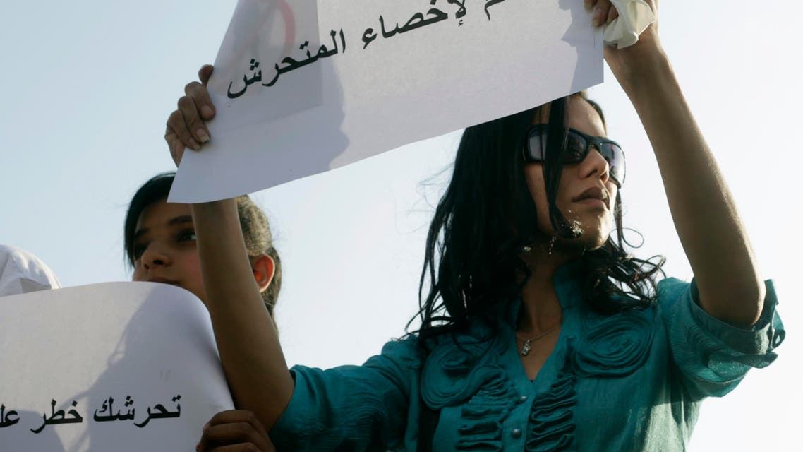 """A female protester holds a sign reading """"Yes to castrating the sexual harasser"""" as she joins others protesting against sexual harassment in Tahrir Square in Cairo June 11, 2014. (Reuters)"""