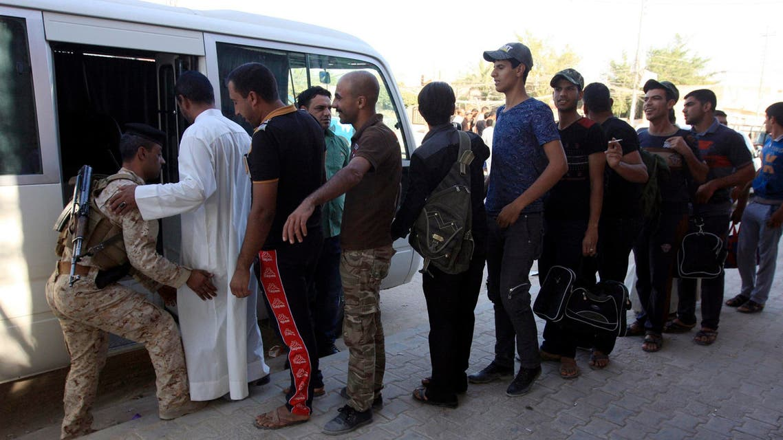 Volunteers, who have joined the Iraqi army to fight against predominantly Sunni militants such as ISIS, prepare to board a bus in Kerbala June 14, 2014. (Reuters)