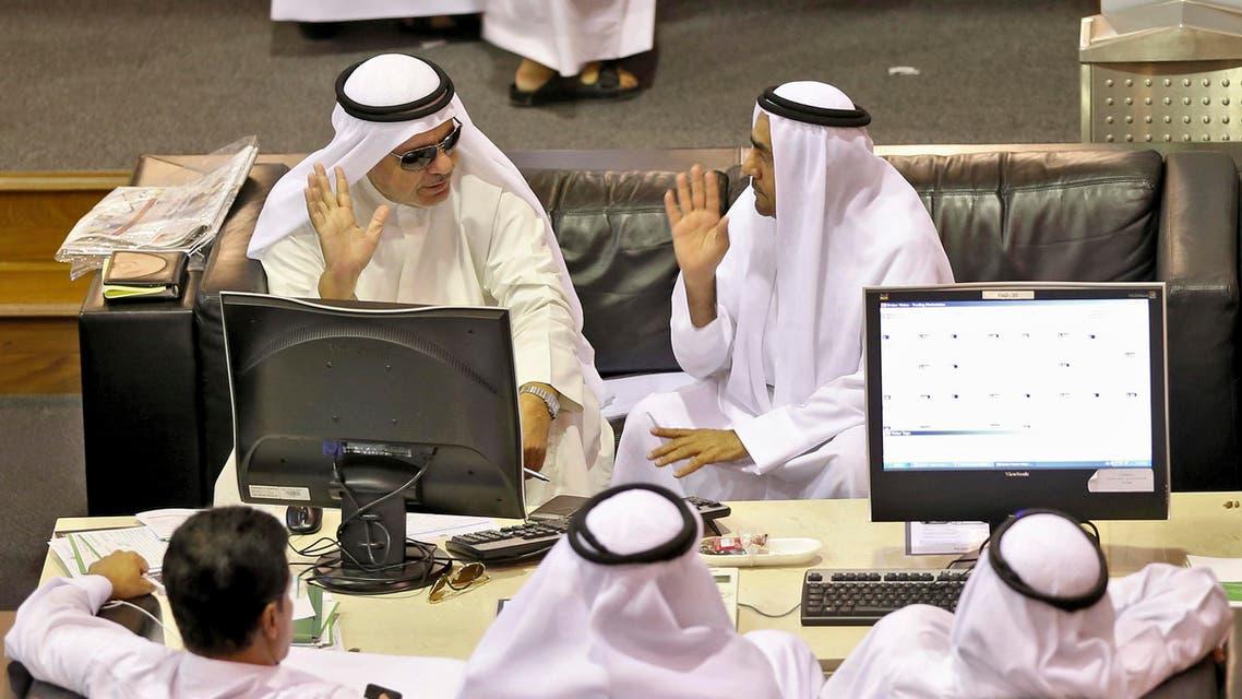 Investors watch a monitor at Dubai Financial Market April 27, 2014. (Reuters) (