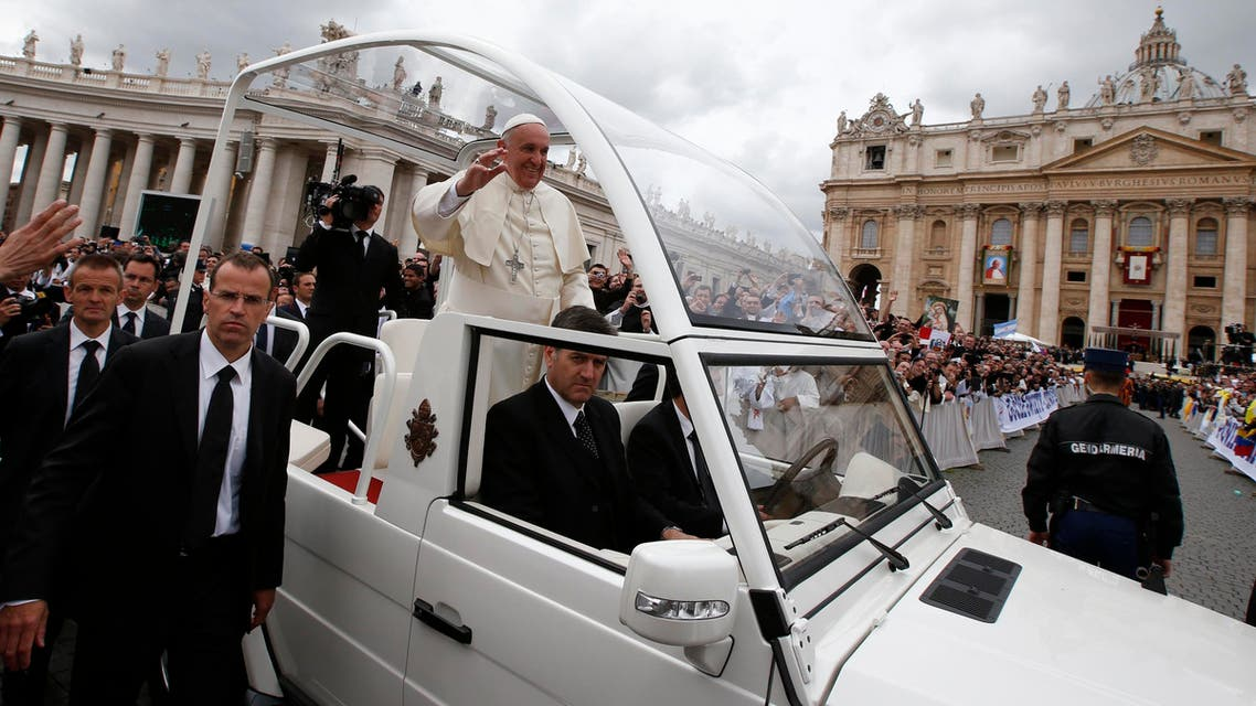 Pope Francis greets the faithful as he rides in his Popemobile after the canonisation ceremony of Popes John XXIII and John Paul II in St Peter's Square at the Vatican, April 27, 2014. (Reuters)