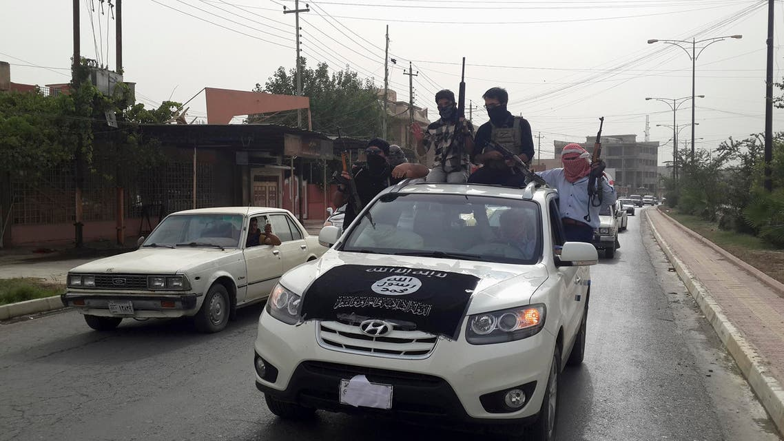 ISIS fighters celebrate on vehicles taken from Iraqi security forces, at a street in city of Mosul, June 12, 2014. (Reuters)