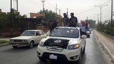 Advancing Iraq rebels seize northwest town in heavy battle