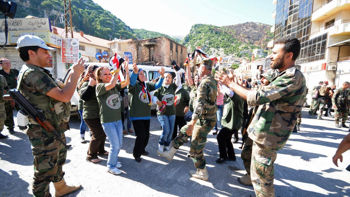 Residents and forces loyal to Syrian President Bashar al-Assad dance along a street in the Armenian Christian town of Kasab June 16, 2014. (Reuters)