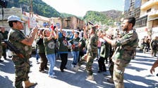 Syria border town residents returning after army ousts rebels