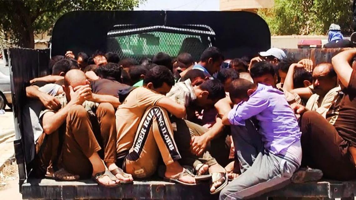 An image uploaded on June 14, 2014 on the jihadist website Welayat Salahuddin allegedly shows militants of the Islamic State of Iraq and the Levant (ISIL) transporting dozens of captured Iraqi security forces  afp