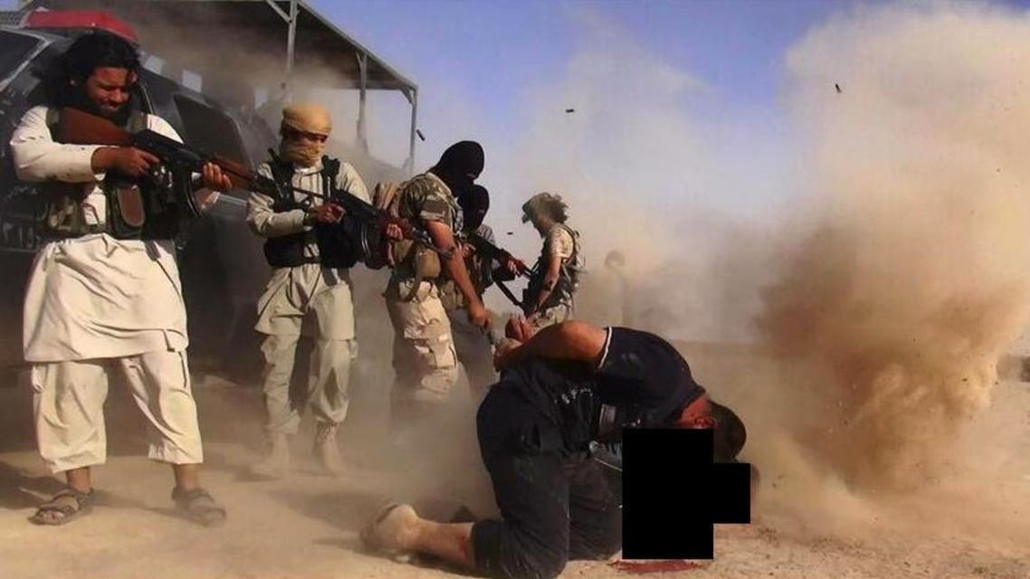 An image made available by the jihadist Twitter account Al-Baraka news on June 16, 2014 allegedly shows Islamic State of Iraq and the Levant (ISIL) militants executing members of the Iraqi forces on the Iraqi-Syrian border.