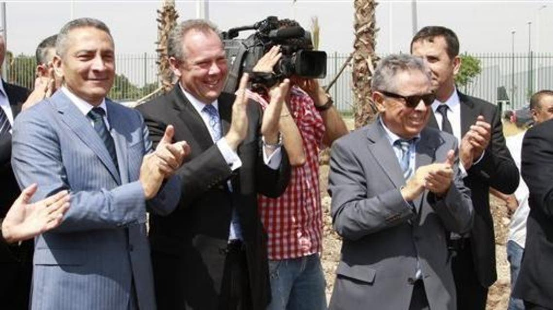 From left, Moroccan Industry Minister Hafid Alamy, Eaton President Frank Campbell and aerospace entrepreneur Hamid Benbrahim applaud Monday, June 16, 2014, as work begins on the new electronics factory near Casablanca Airport. (Photo courtesy of the Associate