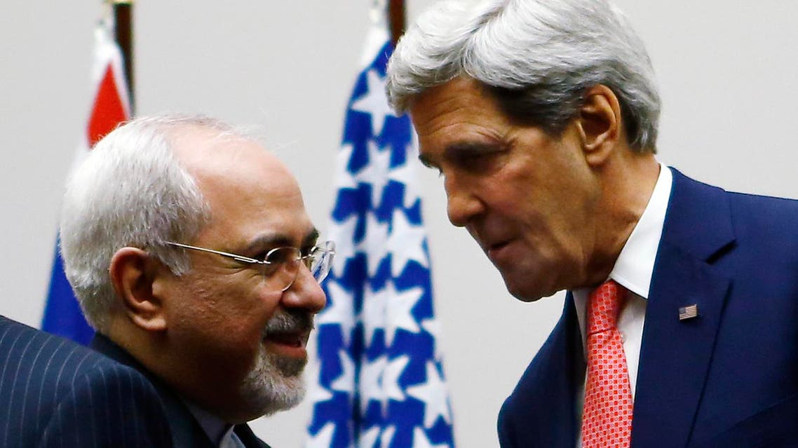 U.S. Secretary of State John Kerry (R) shakes hands with Iranian Foreign Minister Mohammad Javad Zarif after a ceremony at the United Nations in Geneva Nov. 24, 2013. (Reuters)