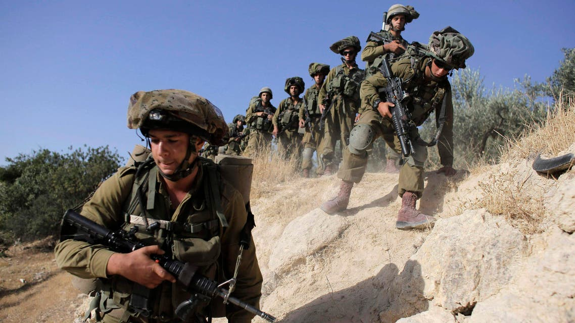 Israeli soldiers take part in an operation to locate three Israeli teens near the West Bank City of Hebron June 17, 2014. reuters