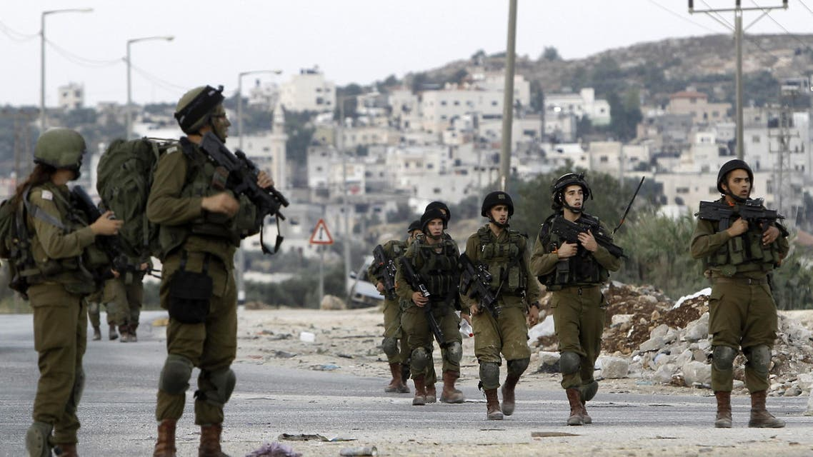 Israeli soldiers patrol the streets of the West Bank city of Nablus on June 17, 2014 as Israeli forces broadened the search for three teenagers believed kidnapped by militants and imposed a tight closure of the town. afp