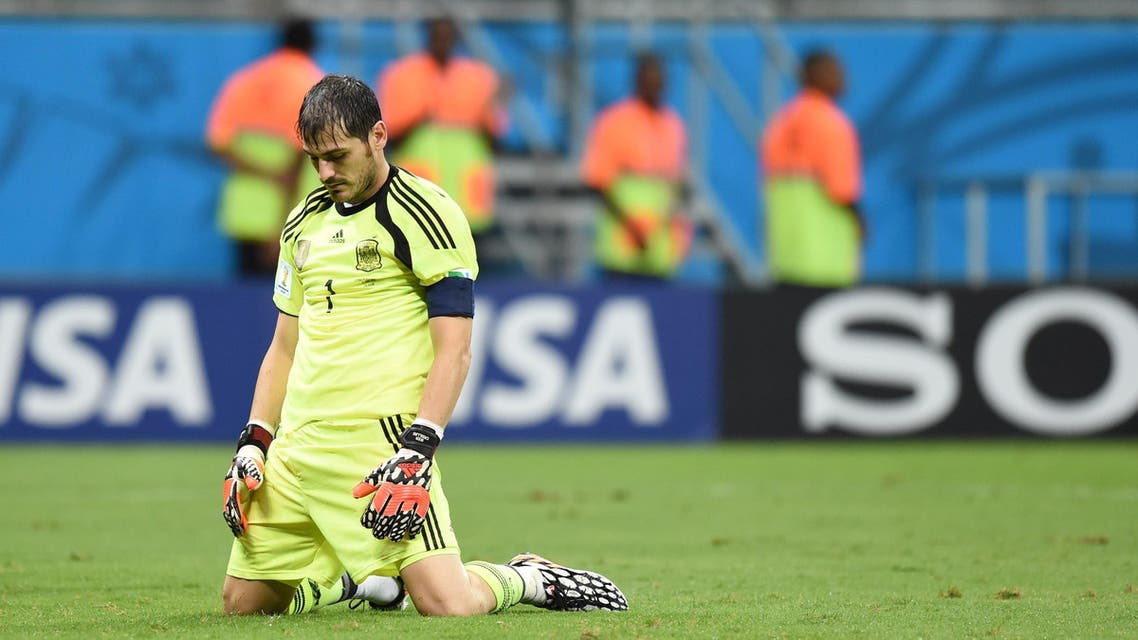 Spain's goalkeeper Iker Casillas reacts after Netherlands' forward Arjen Robben (not seen) scored his team's fifth goal during a Group B football match between Spain and the Netherlands at the Fonte Nova Arena in Salvador during the 2014 FIFA World Cup on June 13, 2014. (AFP)