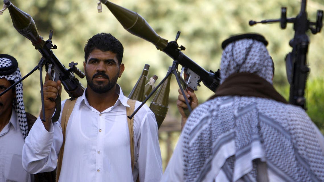Iraqi Shiite tribesmen hold rocket propelled grenade launchers as they gather to show their readiness to join Iraqi security forces on June 16 2014. (AFP)