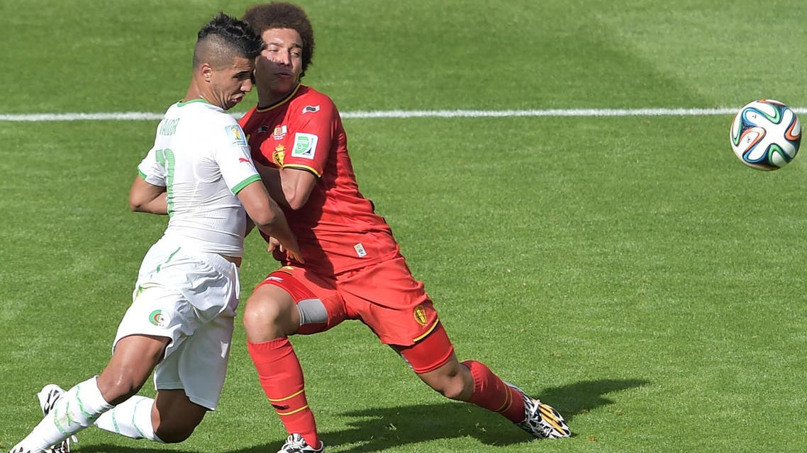 Algeria's midfielder Saphir Taider (L) challenges Belgium's midfielder Axel Witsel during the Group H football match between Belgium and Algeria at the Mineirao Stadium in Belo Horizonte during the 2014 FIFA World Cup on June 17, 2014. (AFP)