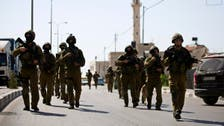 Israel arrests 65 Palestinians as it presses hunt for teens