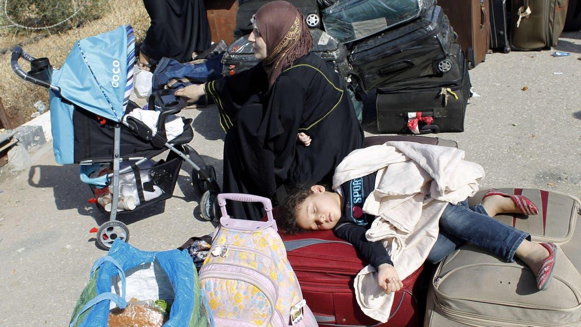 Palestinians wait at the Rafah crossing