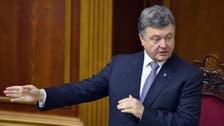 الرئيس الأوكراني يرفع علم بلاده في معقل الانفصاليين
