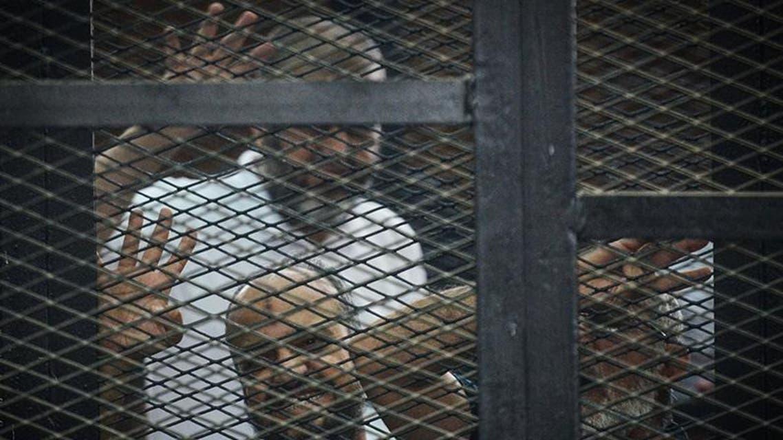 قيادات الاخوان البلتاجي و الشاطر وبديع اثناء المحاكمة في مصر