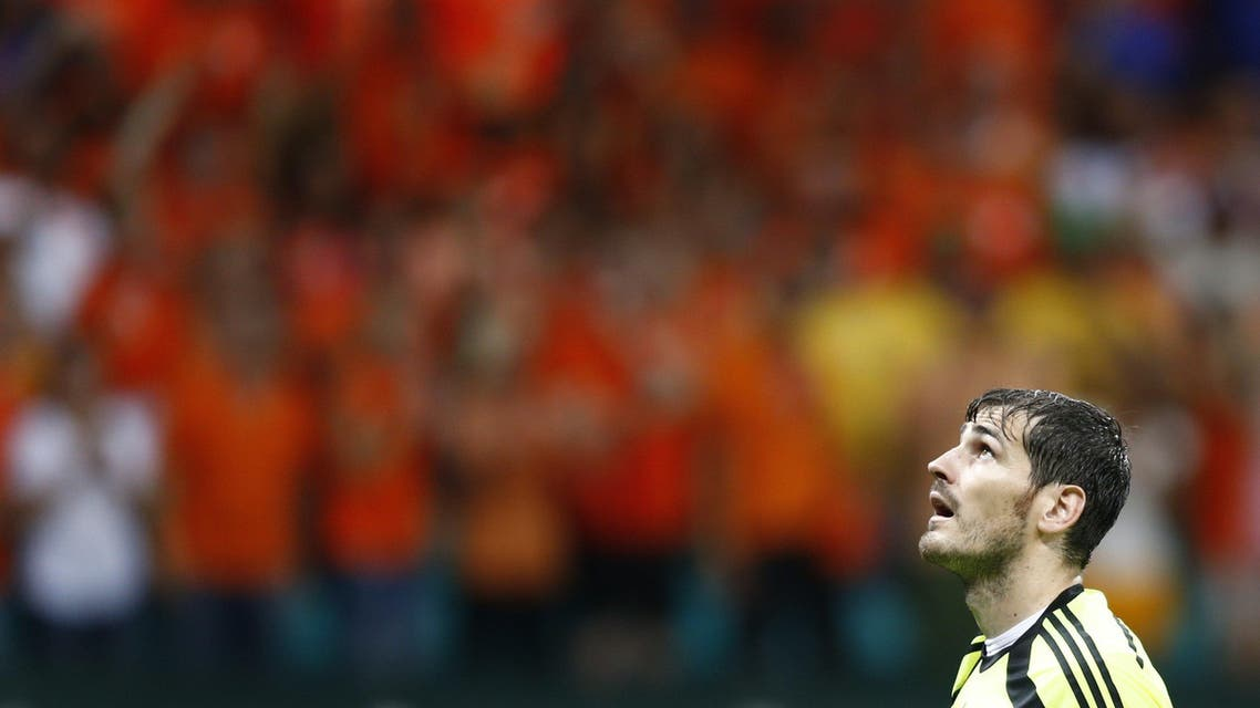 Spain's goalkeeper Iker Casillas reacts after a goal by Netherlands during their 2014 World Cup Group B soccer match at the Fonte Nova arena in Salvador June 13,2014. (Reuters)