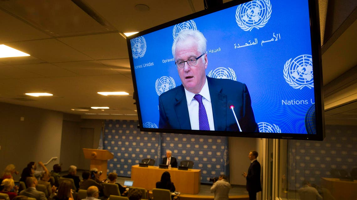 Russia's United Nations Ambassador Vitaly Churkin is shown on a television as he speaks during a news conference in New York June 3, 2014. (AFP)