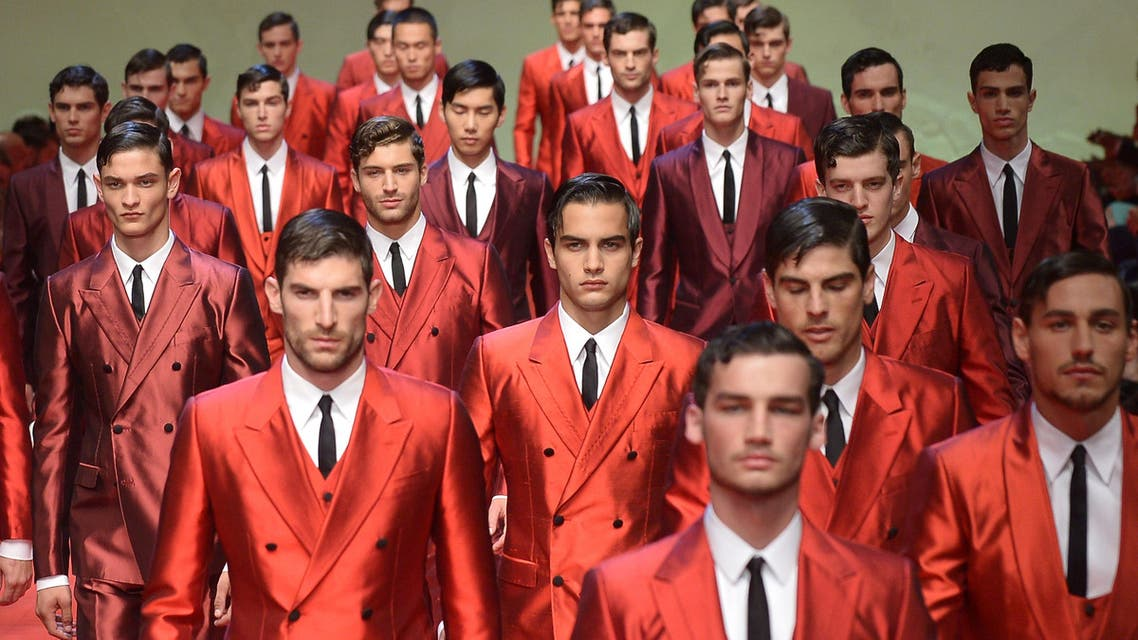 Models present creations for Dolce Gabbana Menswear Spring-Summer 2014 collection on June 21, 2014 during the Men's fashion week in Milan. (AFP)