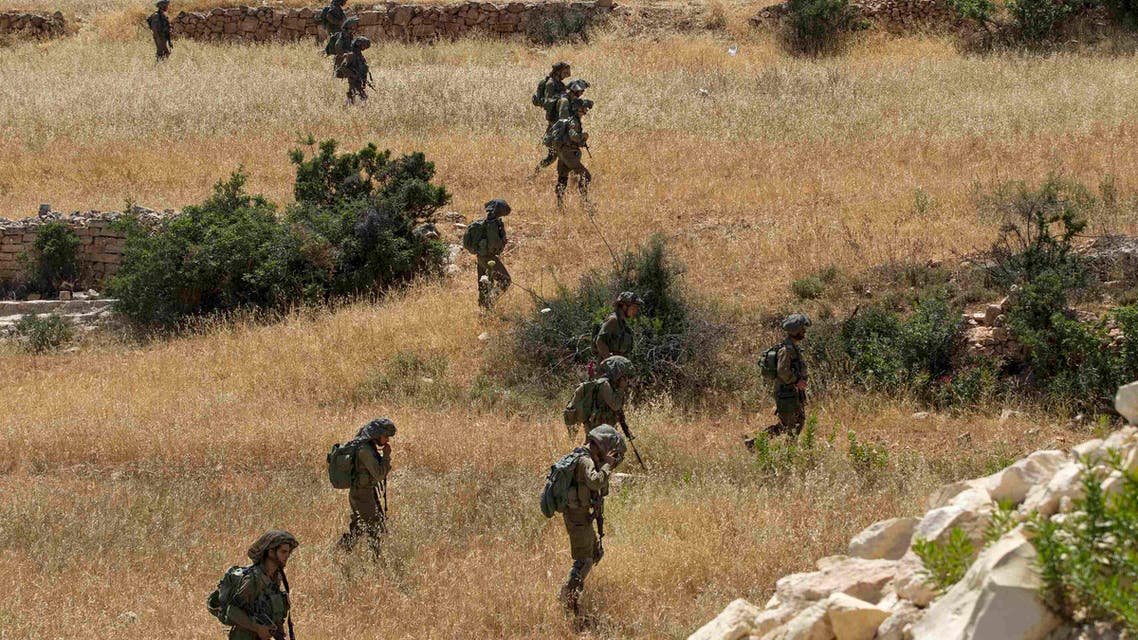 Israeli soldiers take part in searches for three Israeli teenagers believed to have been abducted by Palestinians near the West Bank city of Hebron June 21, 2014.