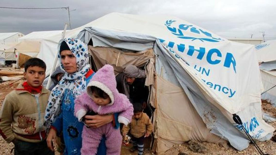 Syrian refugees on Tuesday at the Zaatari camp in Jordan, where violence followed heavy rains.  (Reuters)