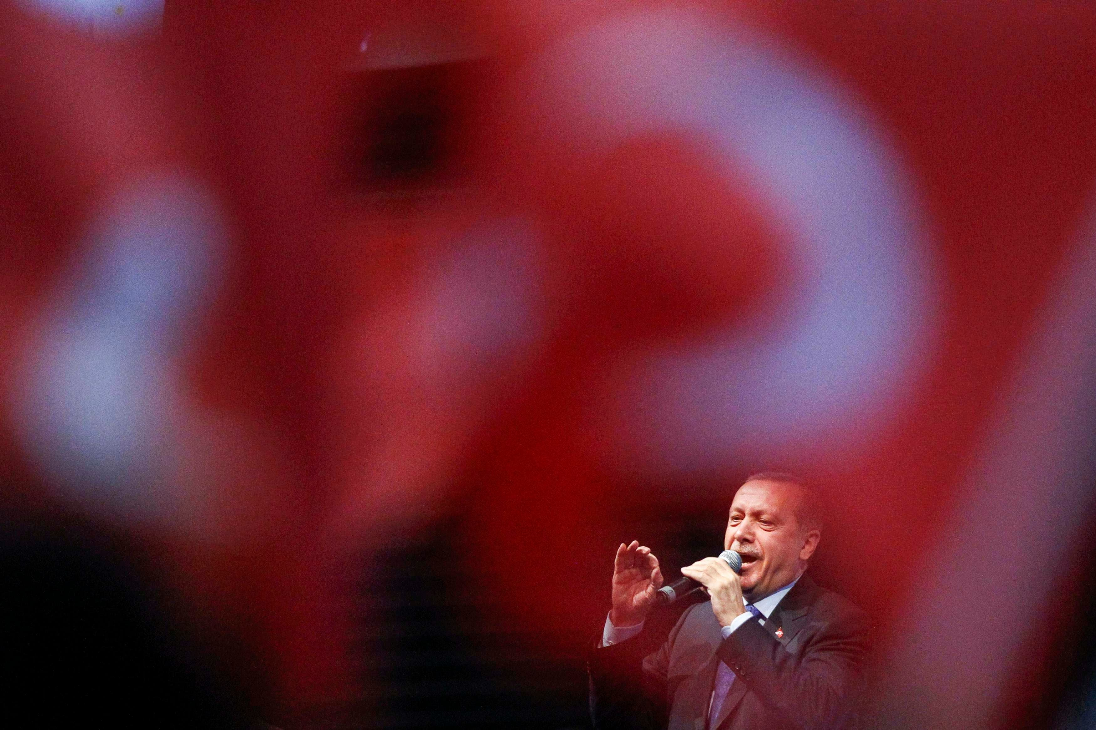 Turkey's Prime Minister Tayyip Erdogan speaks as he attends a political rally for members of the expatriate Turk community in Chassieu, near Lyon, June 21, 2014. (Reuters)