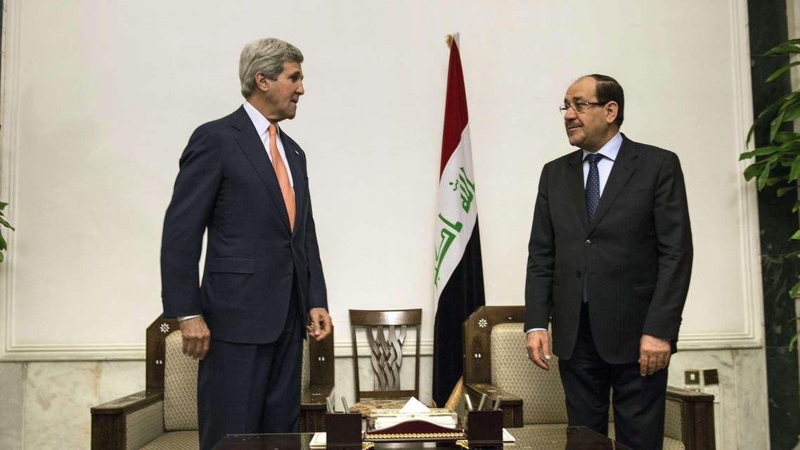 Iraqi Prime Minister Nuri al-Maliki (R) and US Secretary of State John Kerry meet at the Prime Minister's Office in Baghdad on June 23, 2014.  AFP