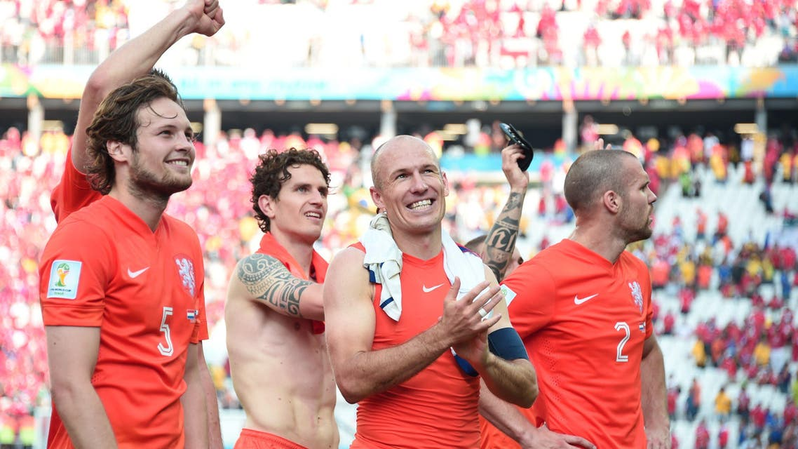 Netherlands' players celebrate after the Group B football match between Netherlands and Chile at the Corinthians Arena in Sao Paulo during the 2014 FIFA World Cup on June 23, 2014. (AFP)