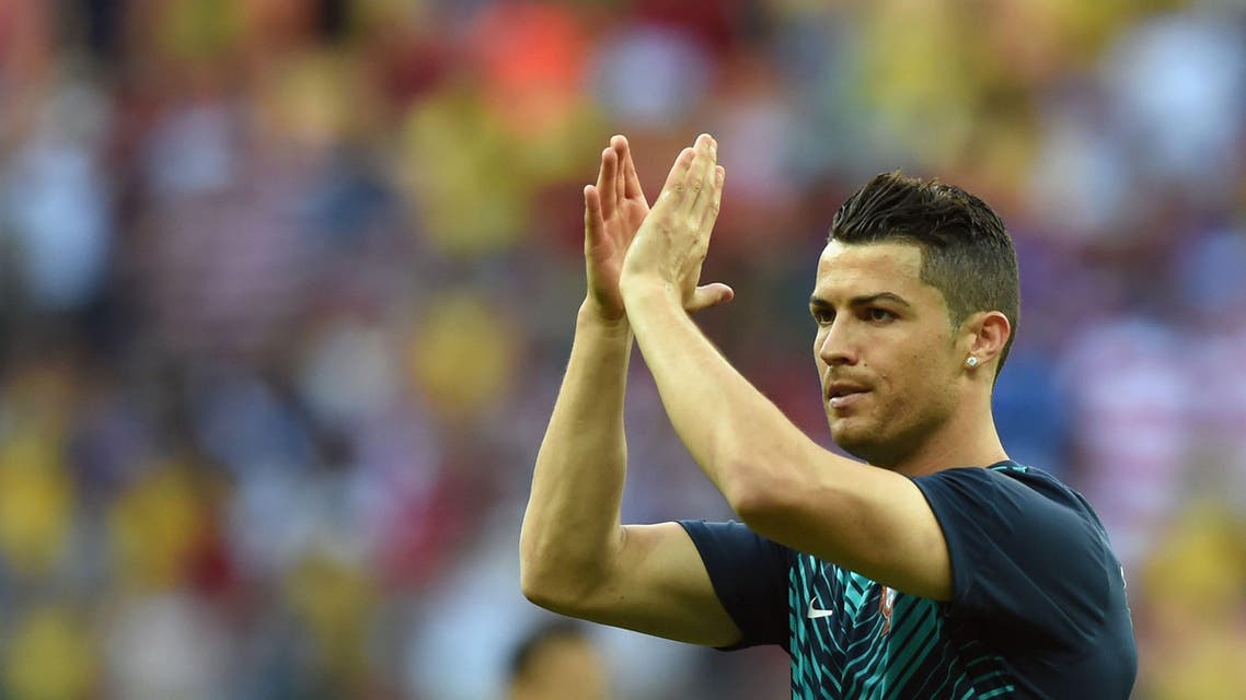 Portugal's forward Cristiano Ronaldo applauds during a warm-up before the start of a Group G match between USA and Portugal at the Amazonia Arena in Manaus during the 2014 FIFA World Cup on June 22, 2014. AFP
