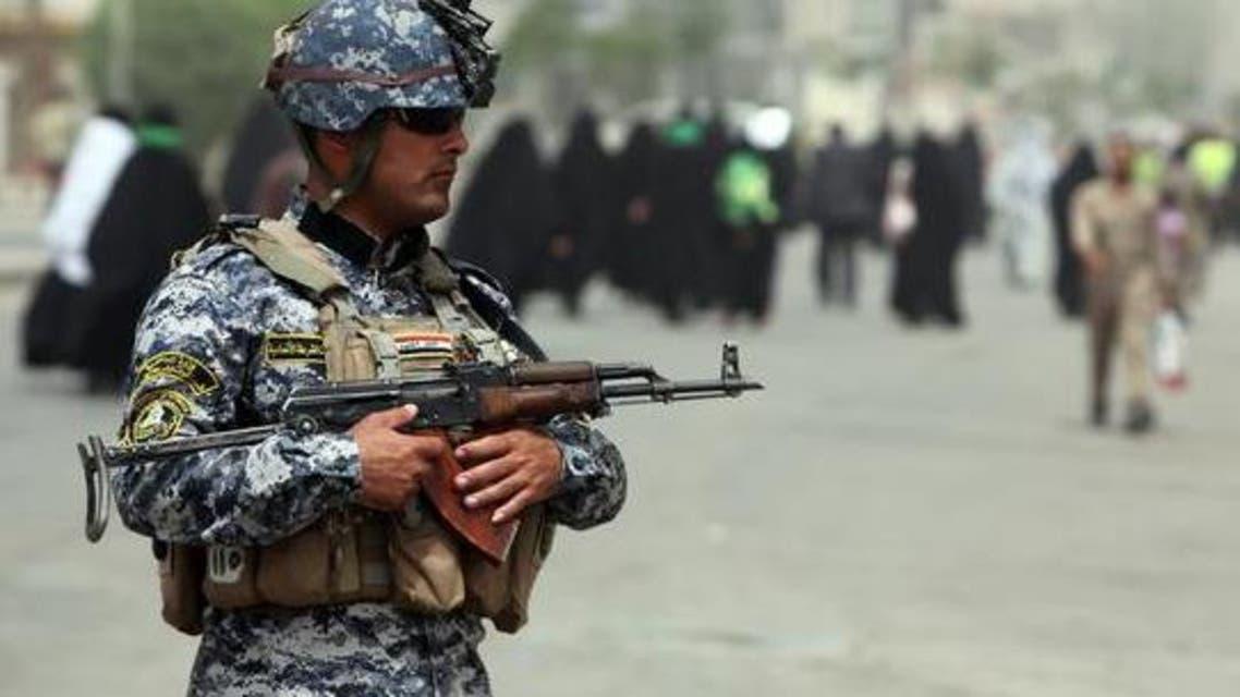أحد عناصر الشرطة العراقية