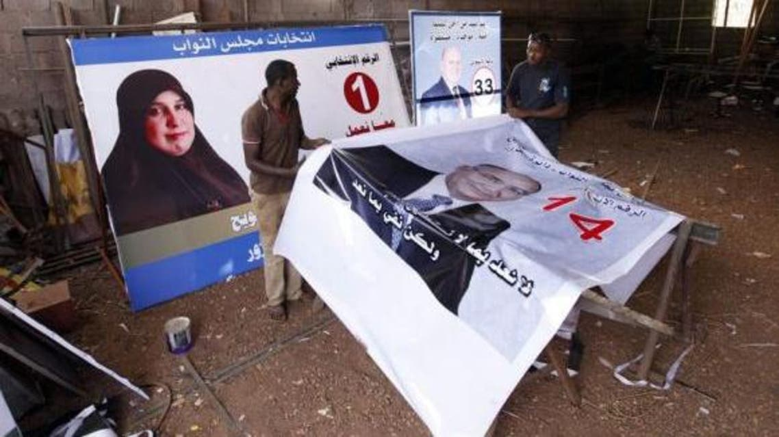 Workers prepare election campaign posters for Libya's House of Representatives in Tripoli June 18, 2014. (Reuters)