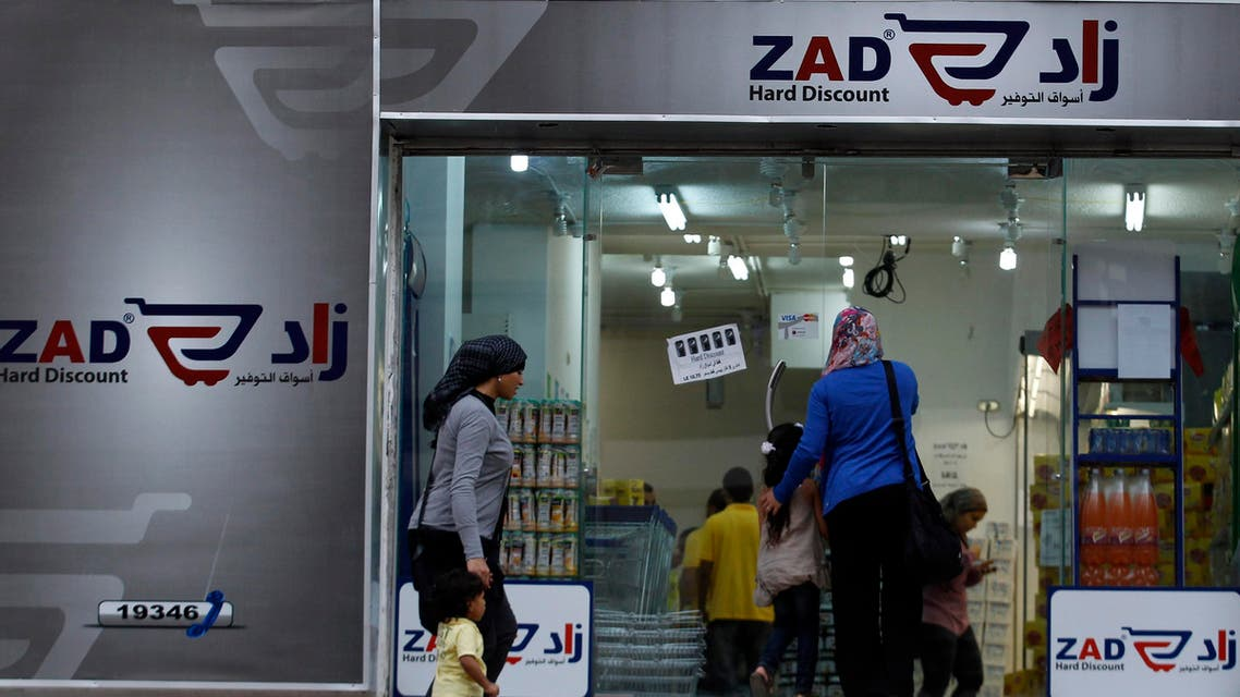 People are seen entering Zad store, established by Khairat al-Shater, a Muslim Brotherhood tycoon and financial strategist, in Cairo October 16, 2012. reuters