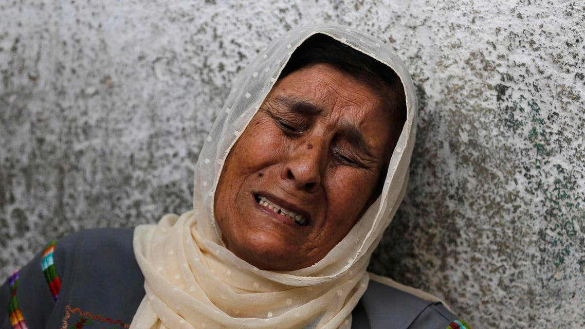 The mother of Palestinian Mohammad Attallah mourns his death at a hospital in Ramallah. He was killed amid the Israli crackdown. (Reuters)