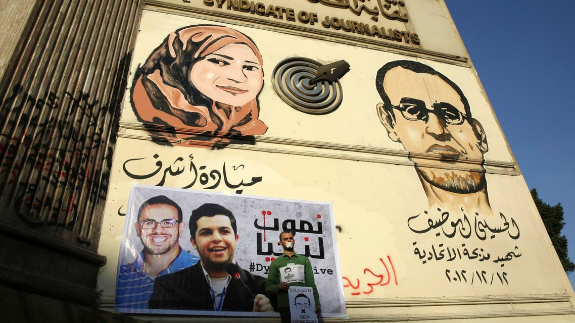 A protester rallies in support of Al Jazeera journalists Abdullah al-Shami and Mohammed Sultan, who were detained by Egyptian authorities, in front of the Press Syndicate in Cairo, June 1, 2014. (Reuters)